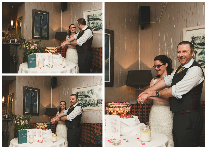 Belfast_wedding_photographer_cutting_the_cake.jpg