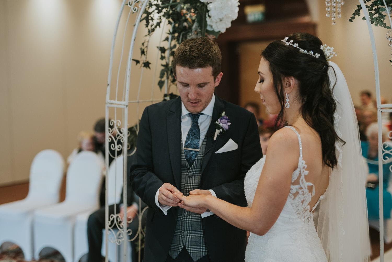 Hilton hotel wedding ceremony bride and groom rings