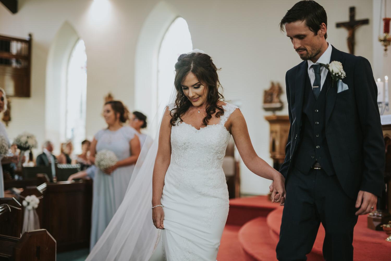 La Mon Hotel wedding ceremony bride and groom