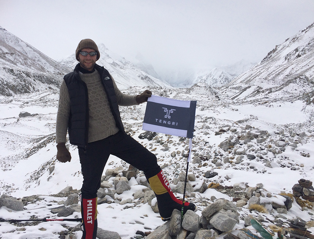 Deri at Everest base camp wearing pieces from  the Tengri Warrior collection : Gloves, Beanie, handknitted Pixane sweater.