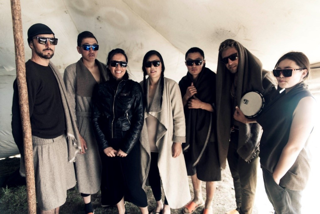 Tengri models pose for a picture backstage with Nancy, Tengri founder (3rd from left) before the show.