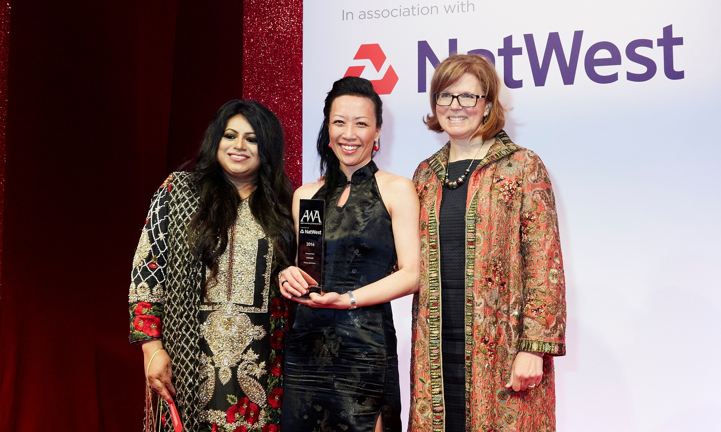 Nancy Johnston was presented the award by Farrah Qureshi from Global Diversity Practice (left) and entrepreneur Sherry Coutu (right)..