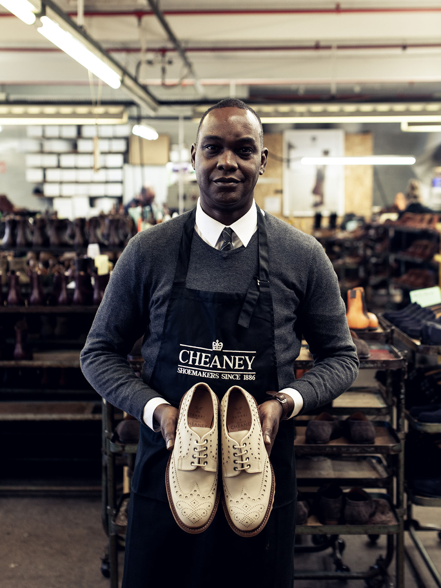 Shoemaker holding a pair of Apex Brogue shoes