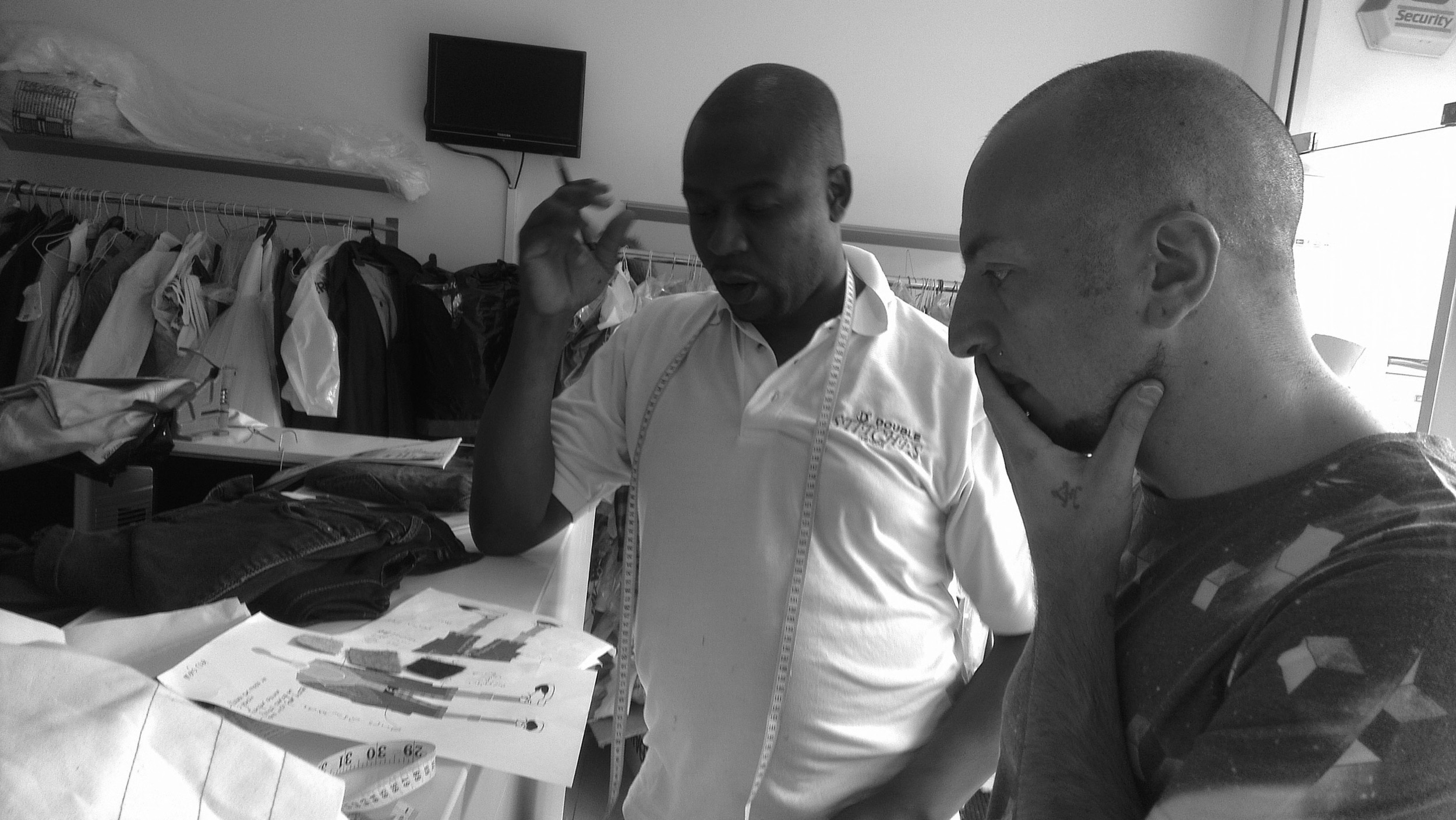 Carlo working with London tailor Udo, whose team helped bring the collection to life