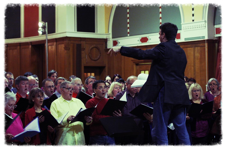 Roly leading a choir of wonderful folk..