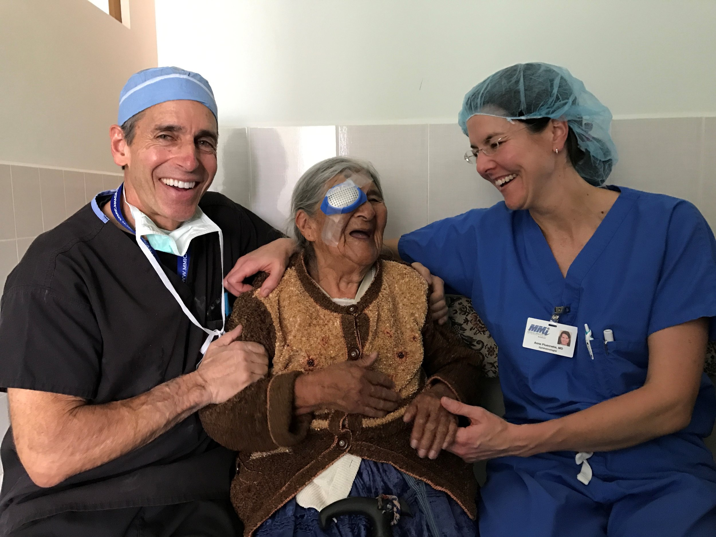 Dr. Rutgard and Dr. Pluenneke post-op with a Bolivian patient