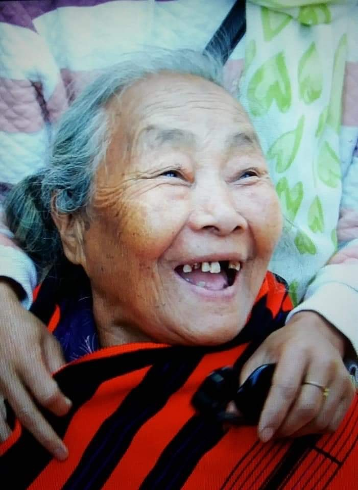 happy grandma after cataract surgery with story.jpg