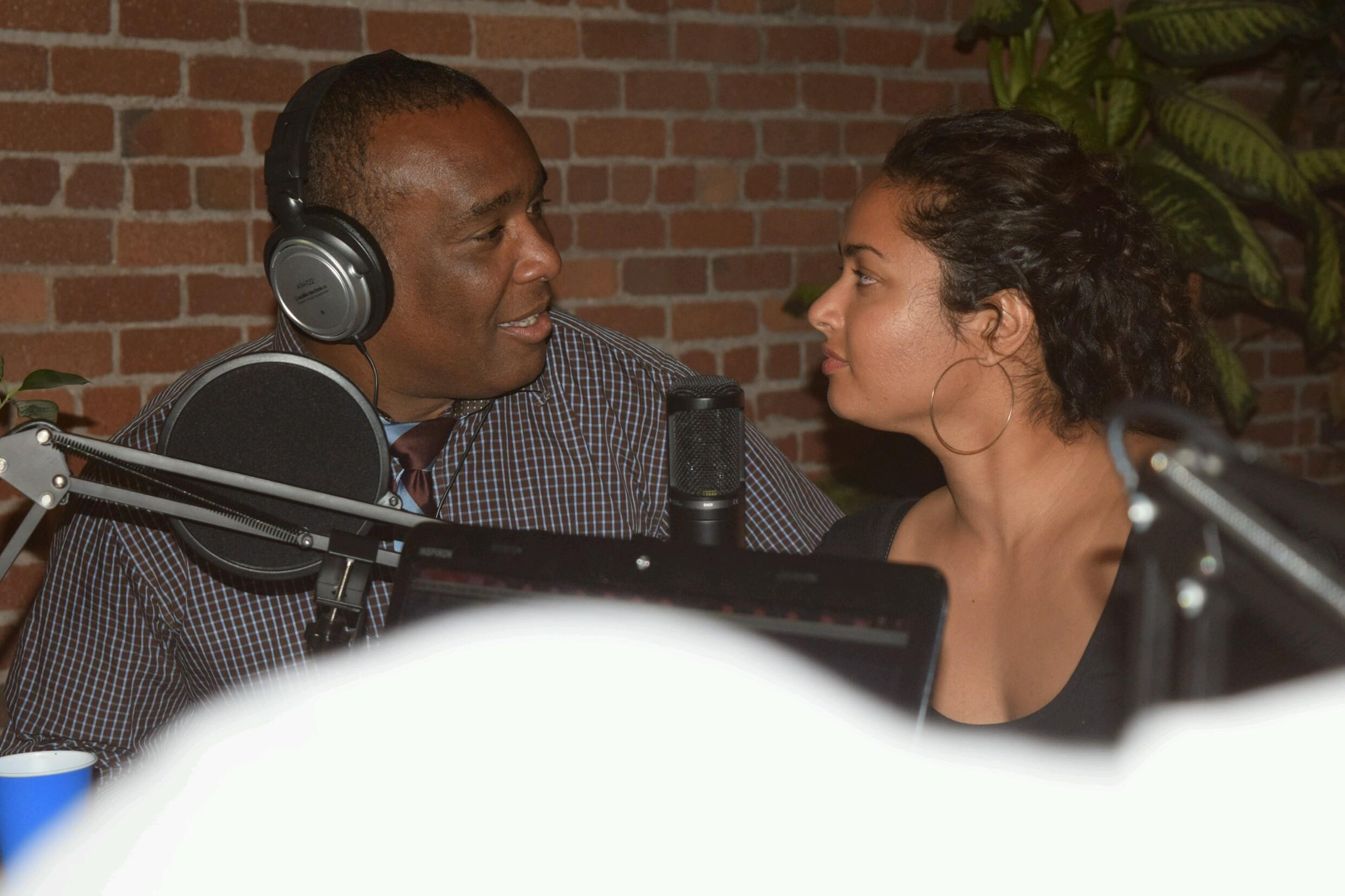 Ebony and slightly less ebony talk together in podcast harmony