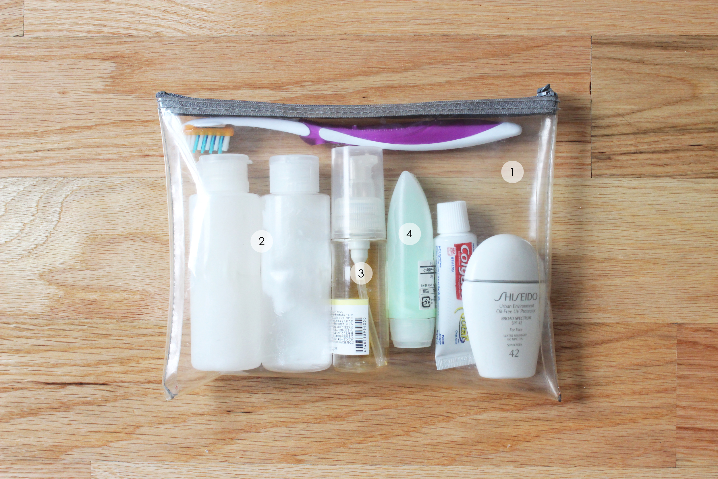 1. Toiletries case ( MUJI ) 2. Shampoo & conditioner bottles ( MUJI ) 3. Hair serum container ( MUJI ) 4. Face wash container ( MUJI )