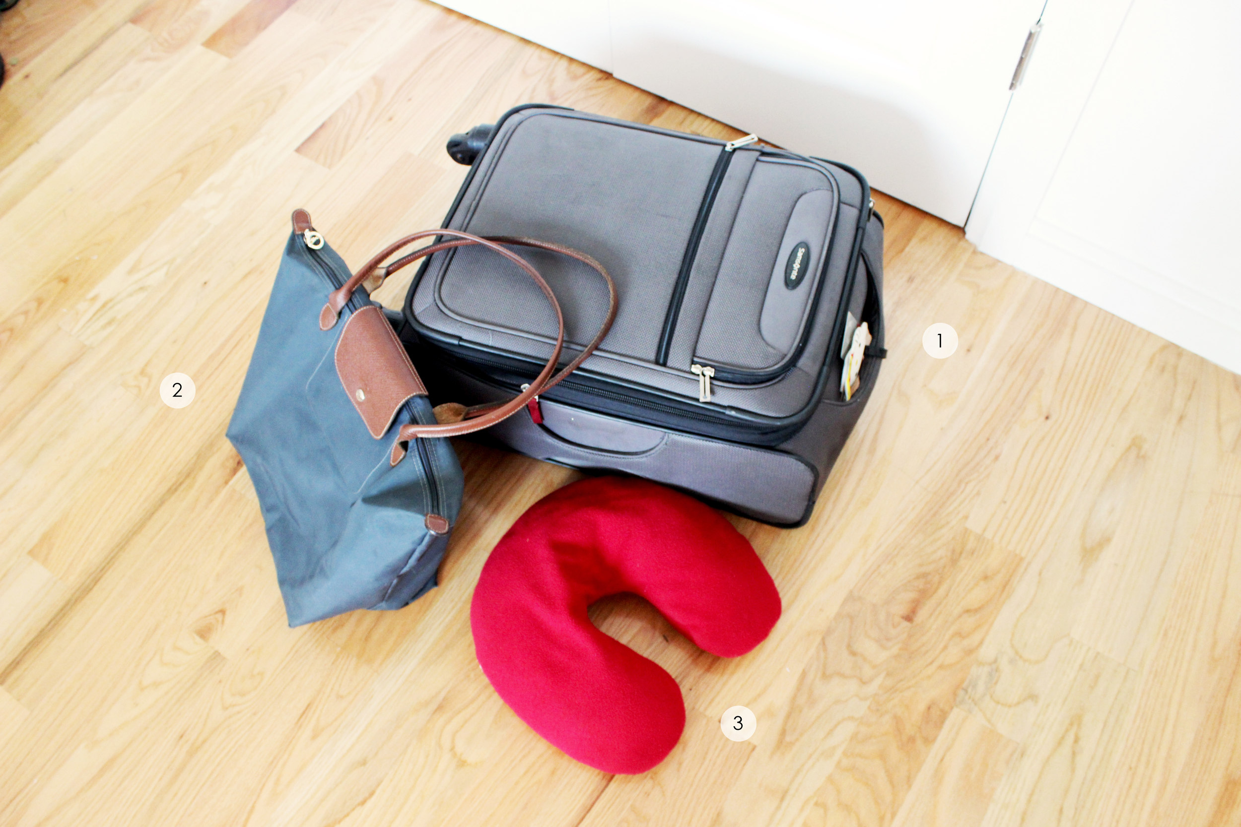 I take three main things with me onto the plane: 1. Carry-on suitcase(  Samsonite  )2. Carry-on tote (  Longchamp  ) 3. My trusty neck pillow ( alternative here   )