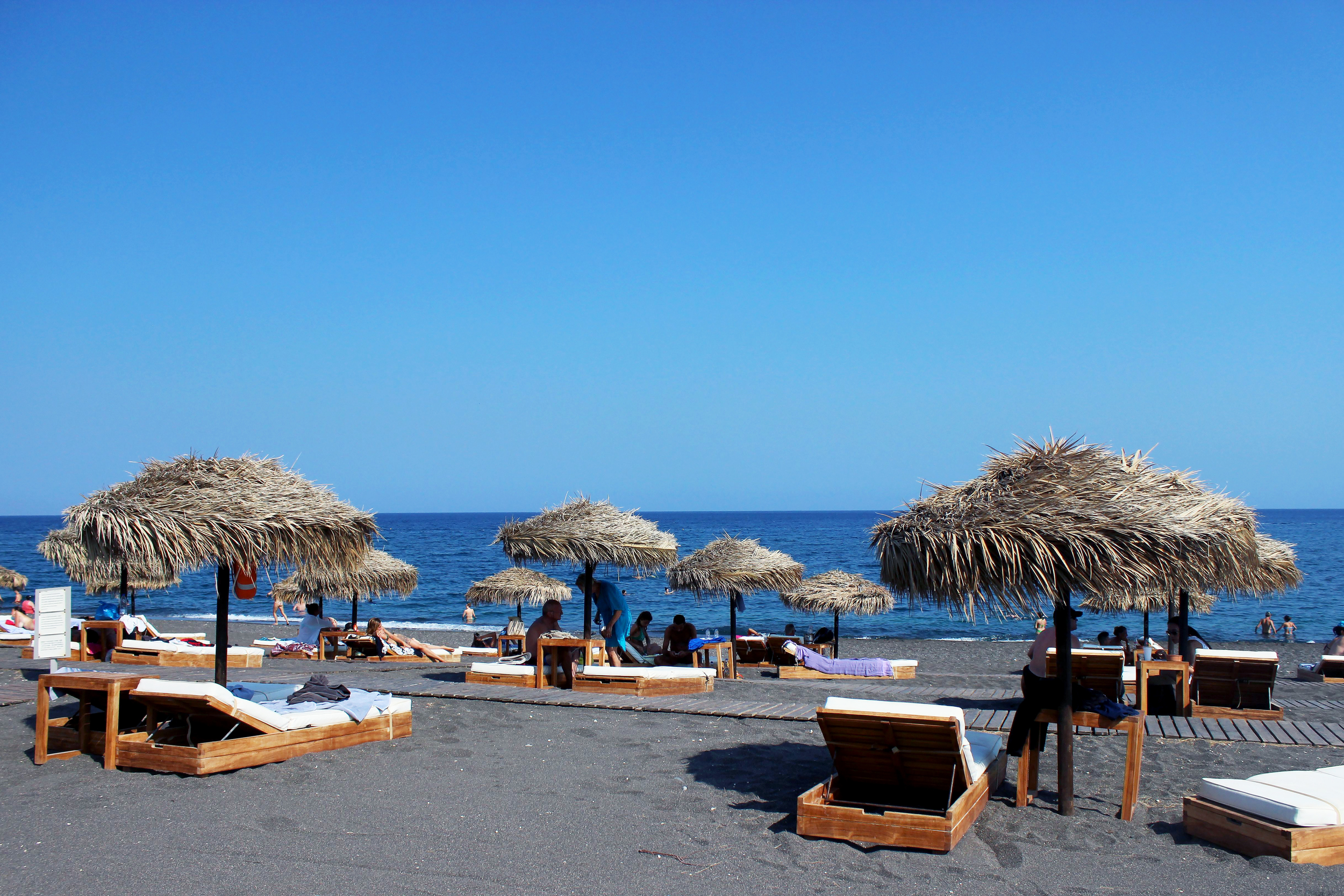 Black Rose Suites' private beachfront at Perissa Beach, included with your Vedema stay