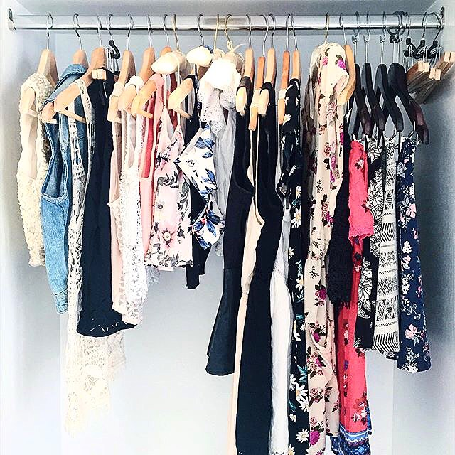 Filling up the suite's closet with my floral wardrobe
