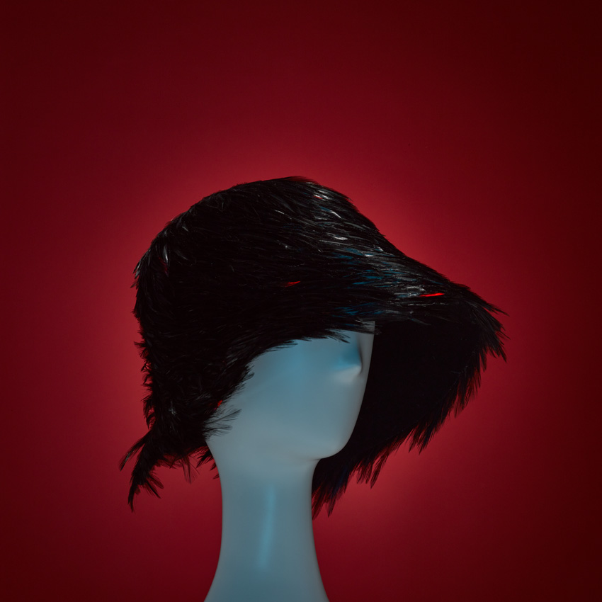 FEATHERED VARVARA   Birds of a feather flock together! Our FEATHERED VARVARA wool cloche with geometric cutout at neckline and hand-appliqued black and red coque feathers. 100% Cotton Japanese grosgrain sweatband.   SHOP THE LOOK HERE!