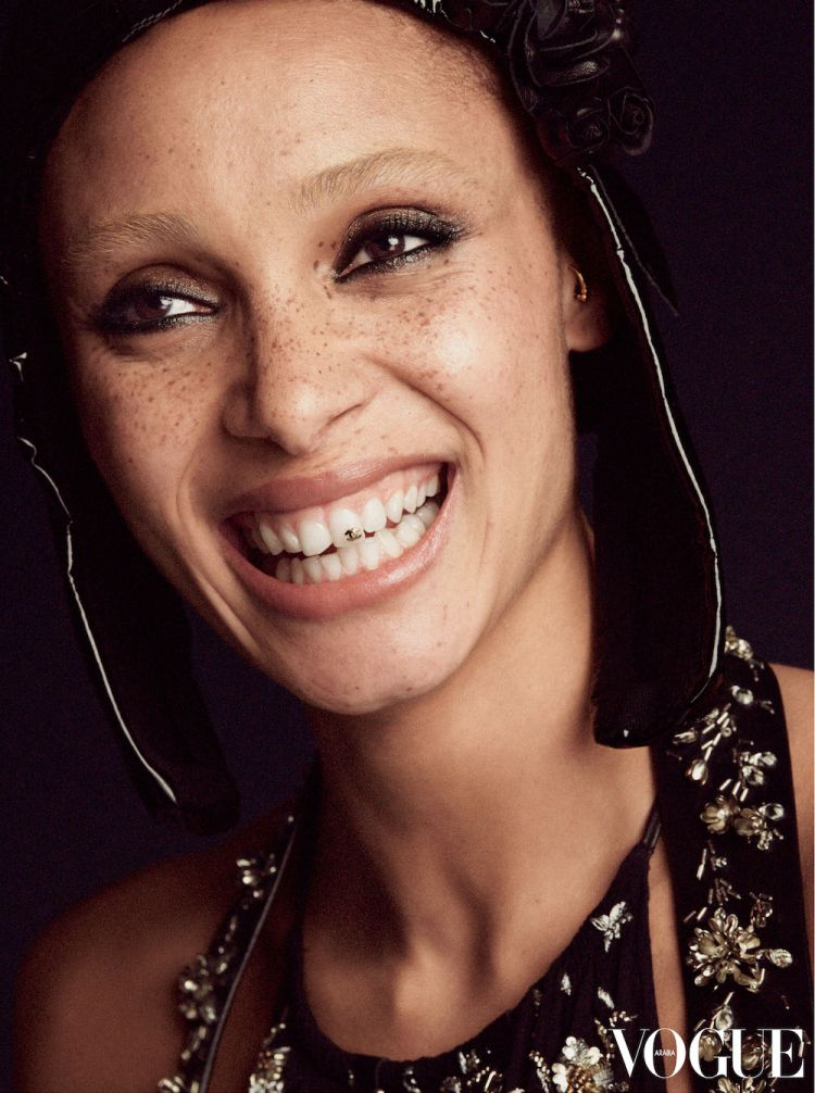 Adwoa Aboah wearing top and dress by Louis Vuitton and Faeth Millinery Rose Stalker hood. Photographed by Cass Bird for Vogue Arabia, April 2018.