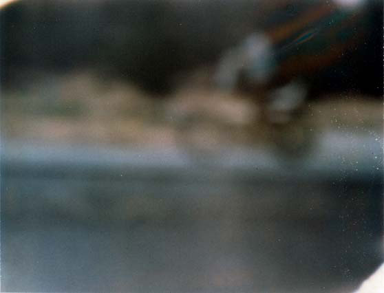 Caught in the Spokes, Polaroid, 2002