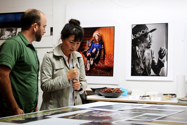 Visitors taking a look at examples of all our photographic papers and archival printing methods.