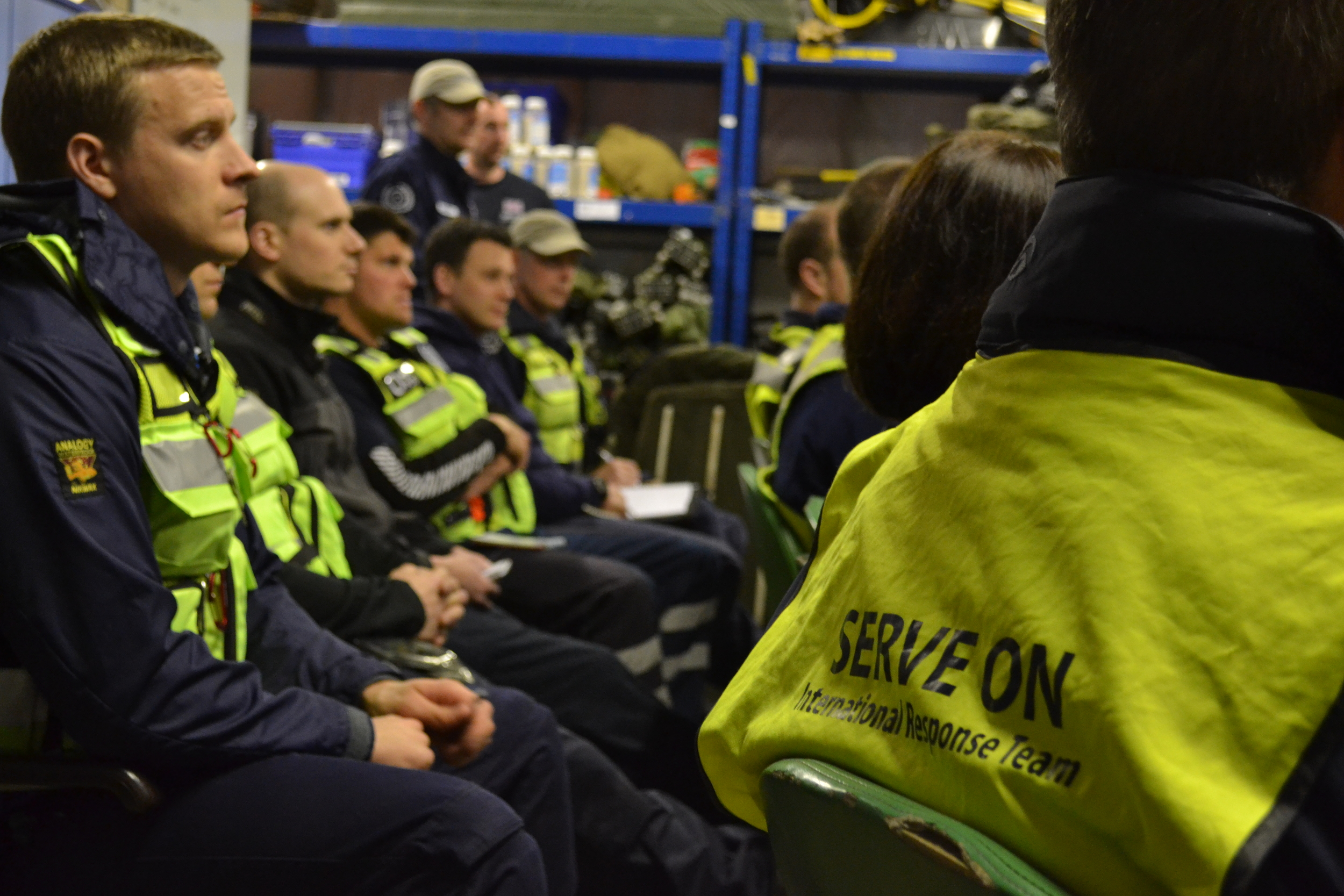 The team listening to the briefing and scenarios