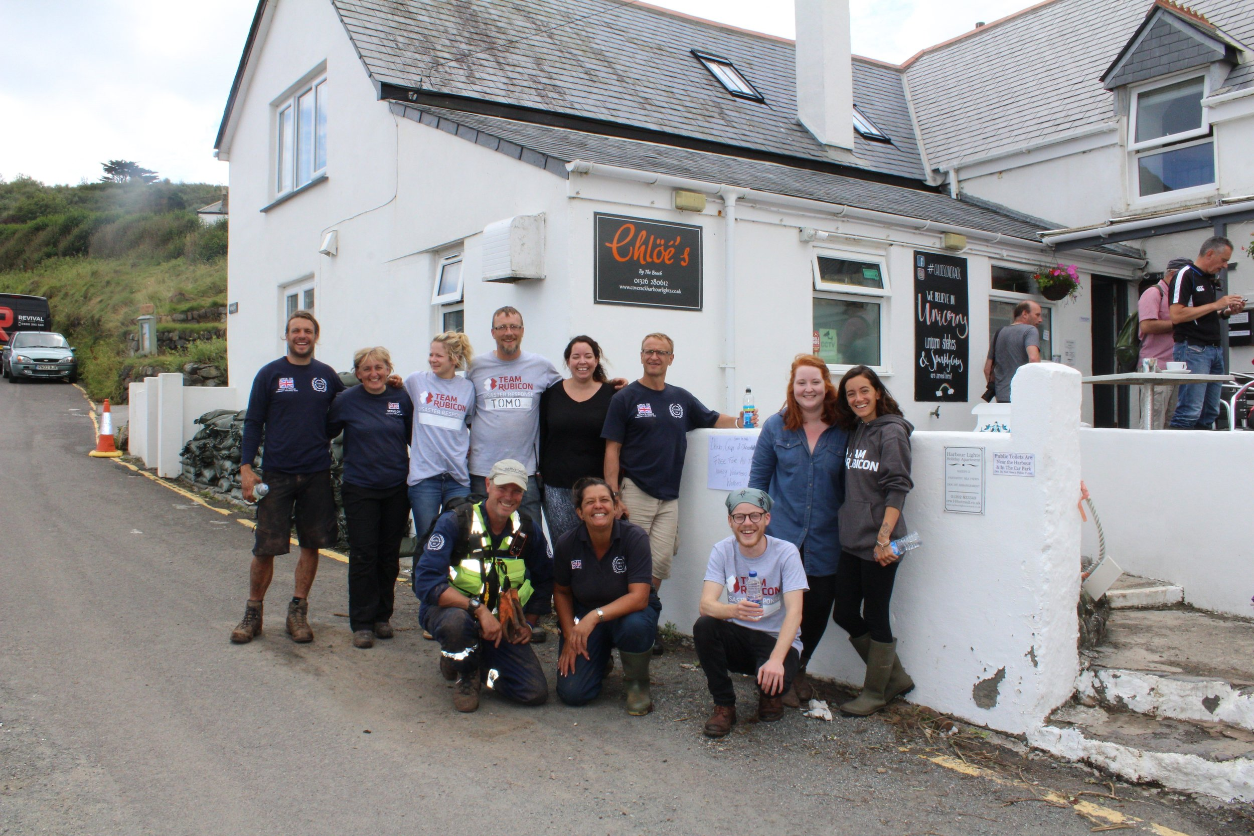 Helen Littlejohn with other Serve On and Team Rubicon volunteers outside Chloe's cafe