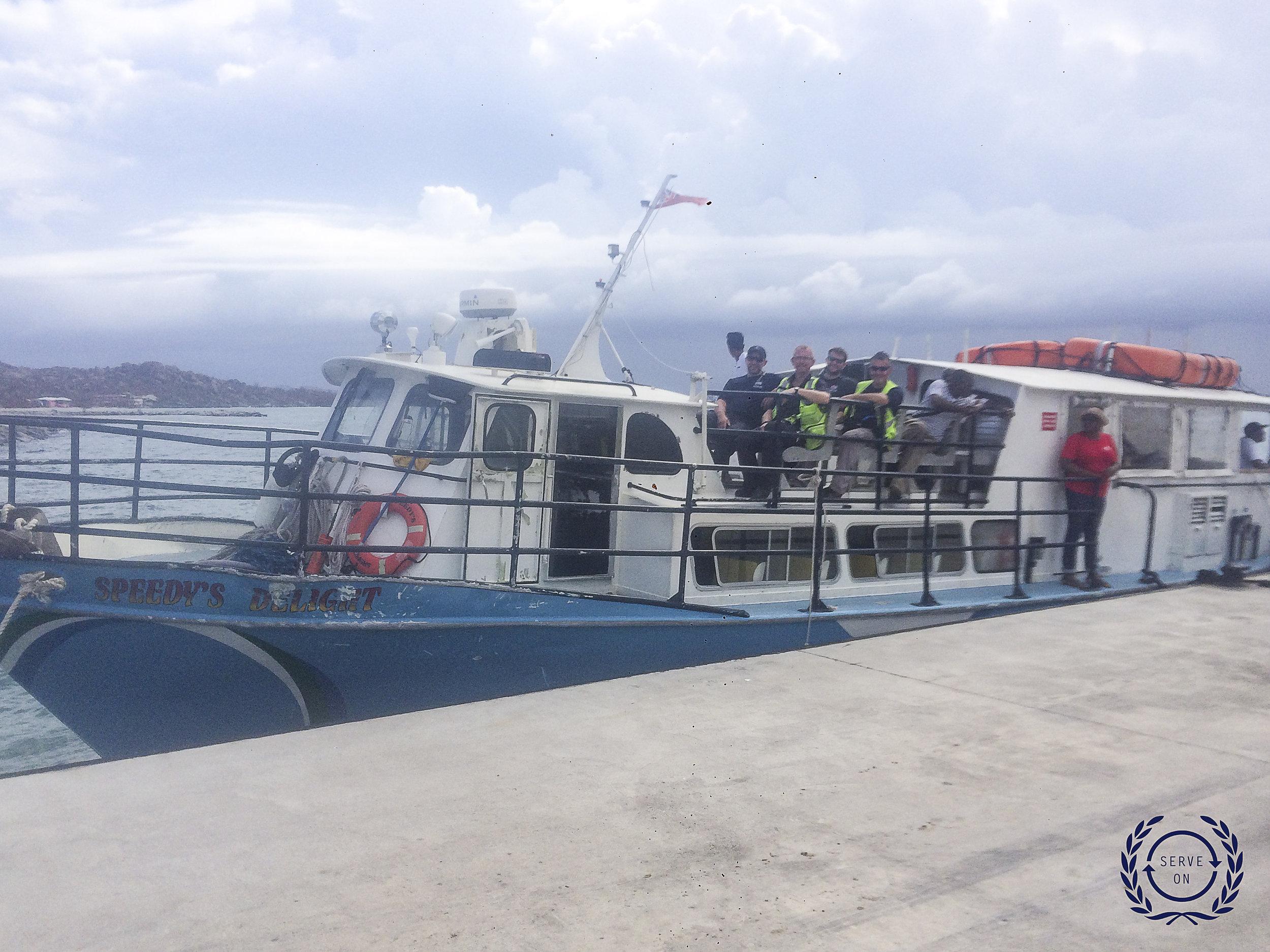 img_1449 - Team departing VG by boat Logo.jpg