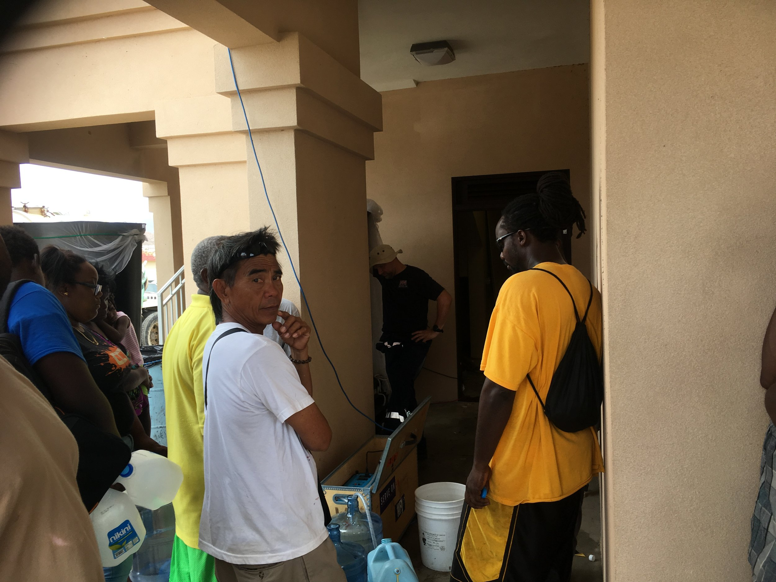 Locals in The Valley area of Virgin Gorda'scapital Spanish Town queued for drinking water produced by our water filtration unit.
