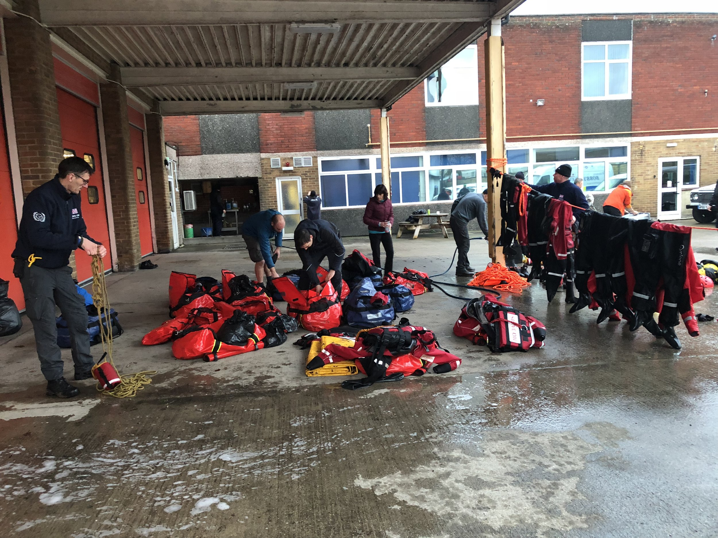 Serve On humanitarian response charity's newest search and rescue recruits wash down their kit after swift water rescue training.