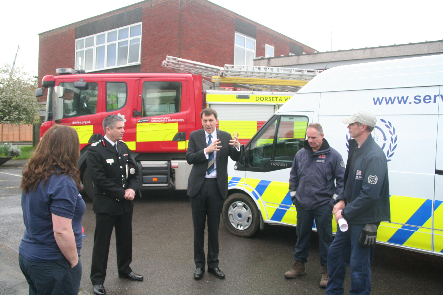 Salisbury MP John Glen congratulates Serve On volunteers on the arrival of a new kit van, thanks to the Big Lottery Fun, as Chief Fire Officer Ben Ansell look on.
