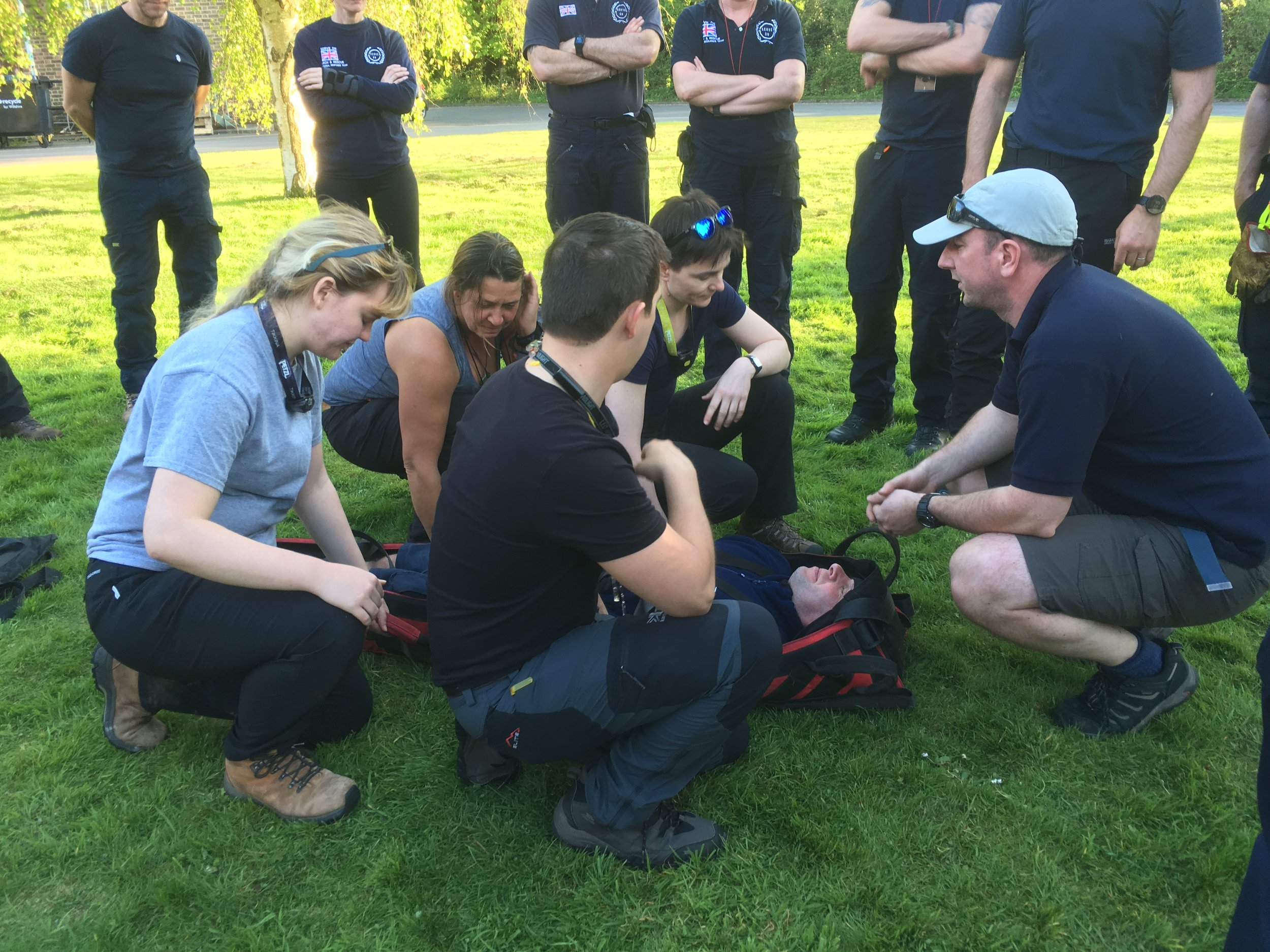 Ian instructing the Serve On International Response Team recruits on stretcher work and casualty handling.