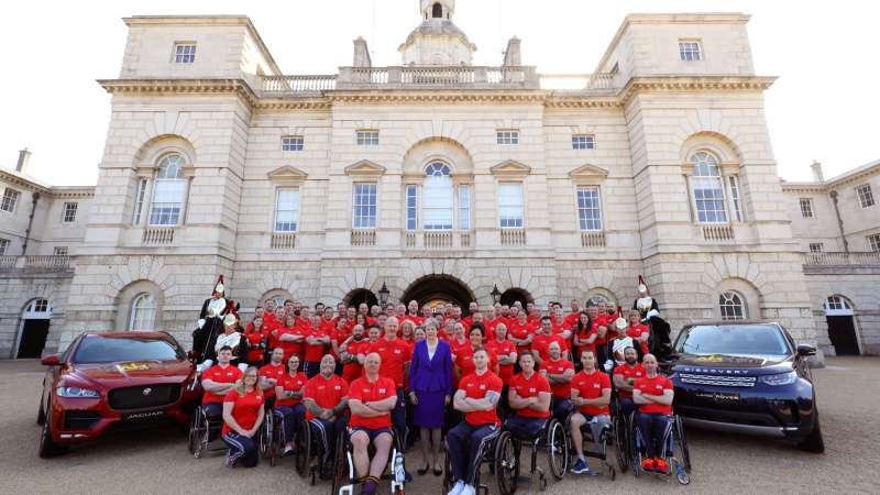 Pete Dunning and other members of the UK Invictus Games team gather in Londons's Horseguards Parade with Prime Minister Theresa May