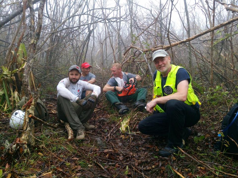 Serve On International Response Team member Simon Thomasson with Team Rubicon UK volunteers cutting a route to the top of Gorda Peak after Hurricane Irma.