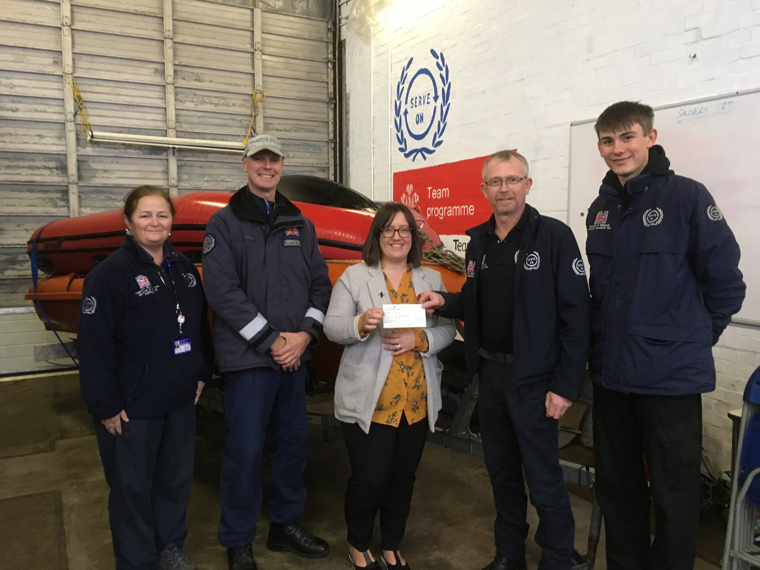 Victoria from The Eight Foundation hands over a cheque to Serve On volunteers Laura, Craig, Martin and Ethan.