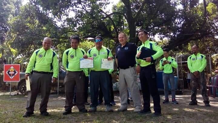 Trainee dog handlers in the new Search and Rescue Unit of Cebu receive their first aid training certificates with Serve On dog handler and medic James Lewis.