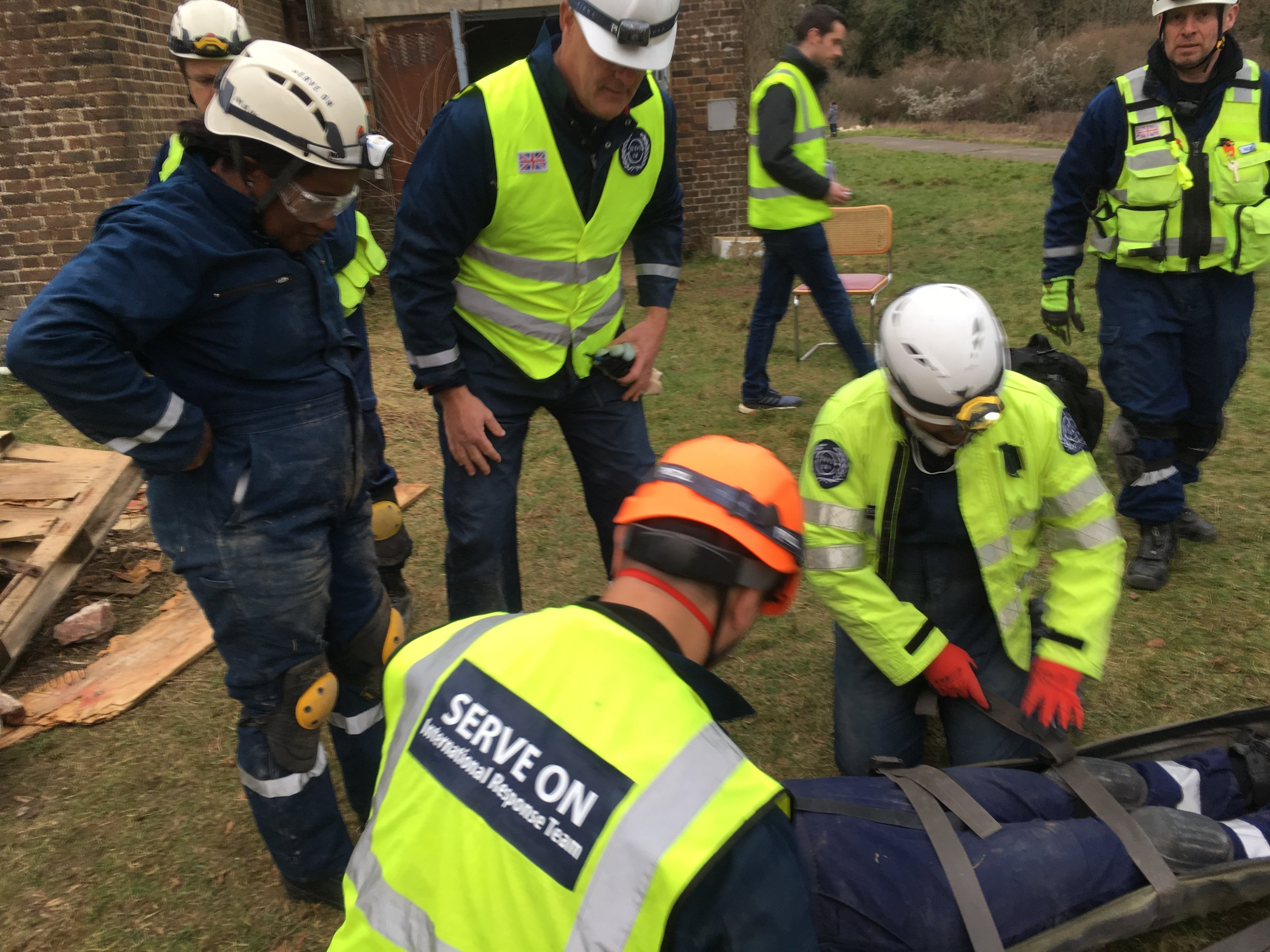 GB Paralympics head coach Paula Dunn and GB Rowing's chief coach for U23s and juniors, Peter Sheppard, help out with a casualty rescue during disaster experience training with Serve On humanitarian response charity. Photo by Martin Phillips, Serve on