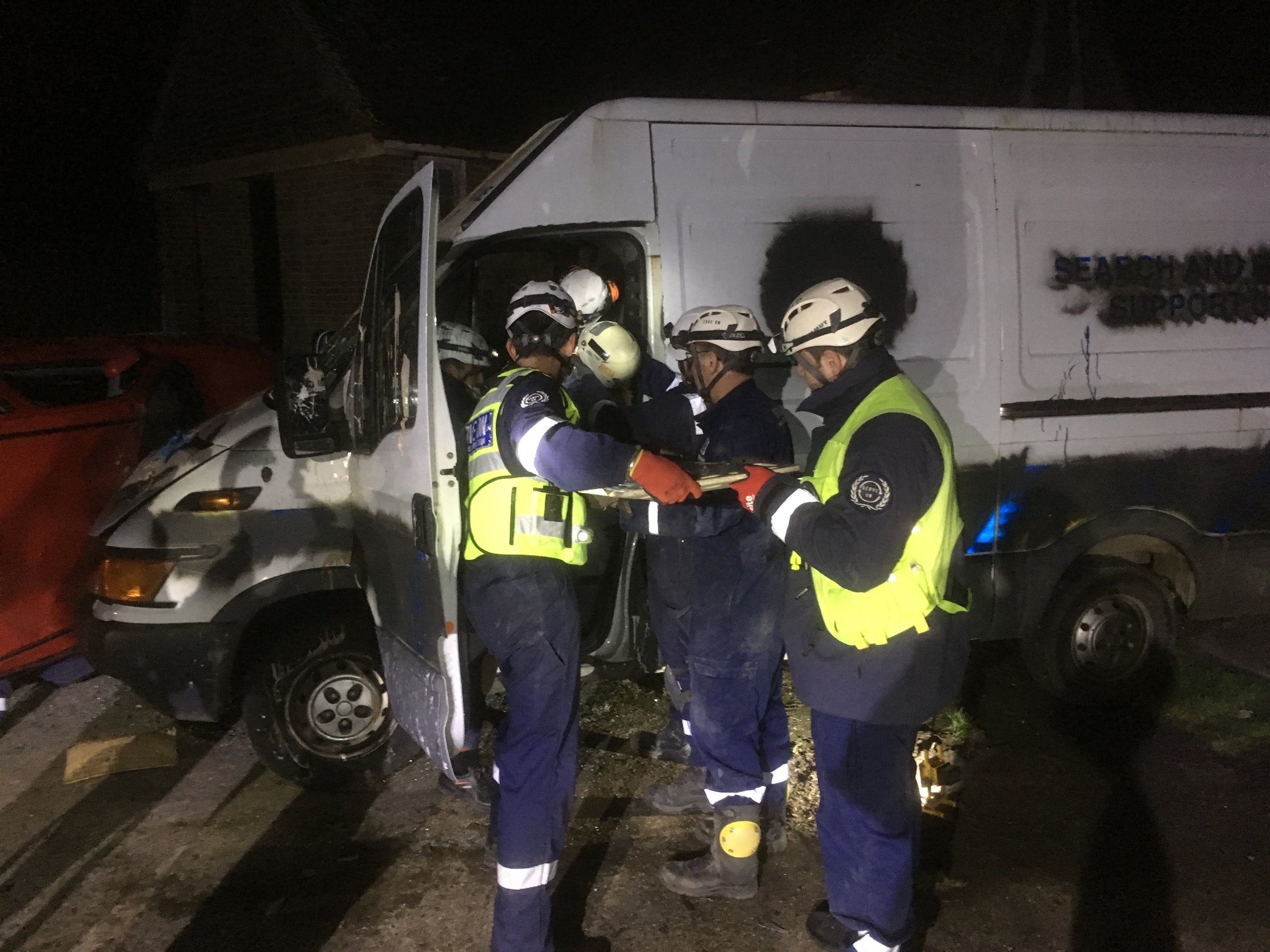 Trainers on the UK Sport elite coaching programme carry out a rescue in a road traffic accident scenario during a disaster experience with Serve On humanitarian response charity.