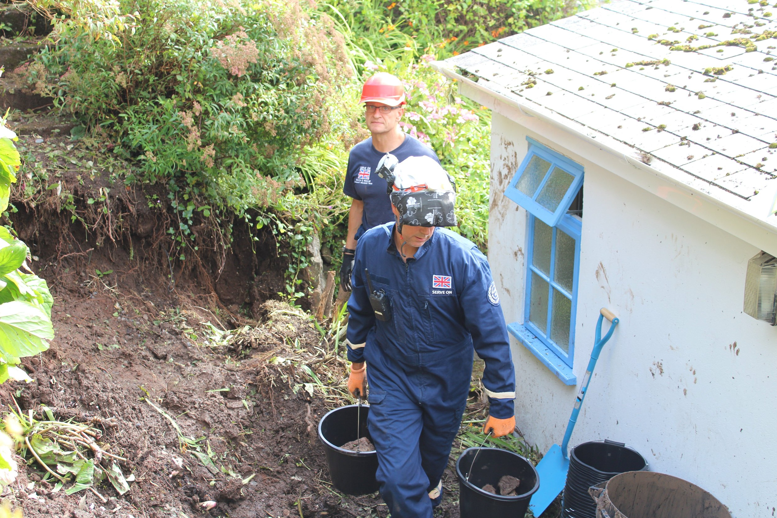 A Serve On team ov volunteers deployed to Coverack to help after flash floods there in 2017.