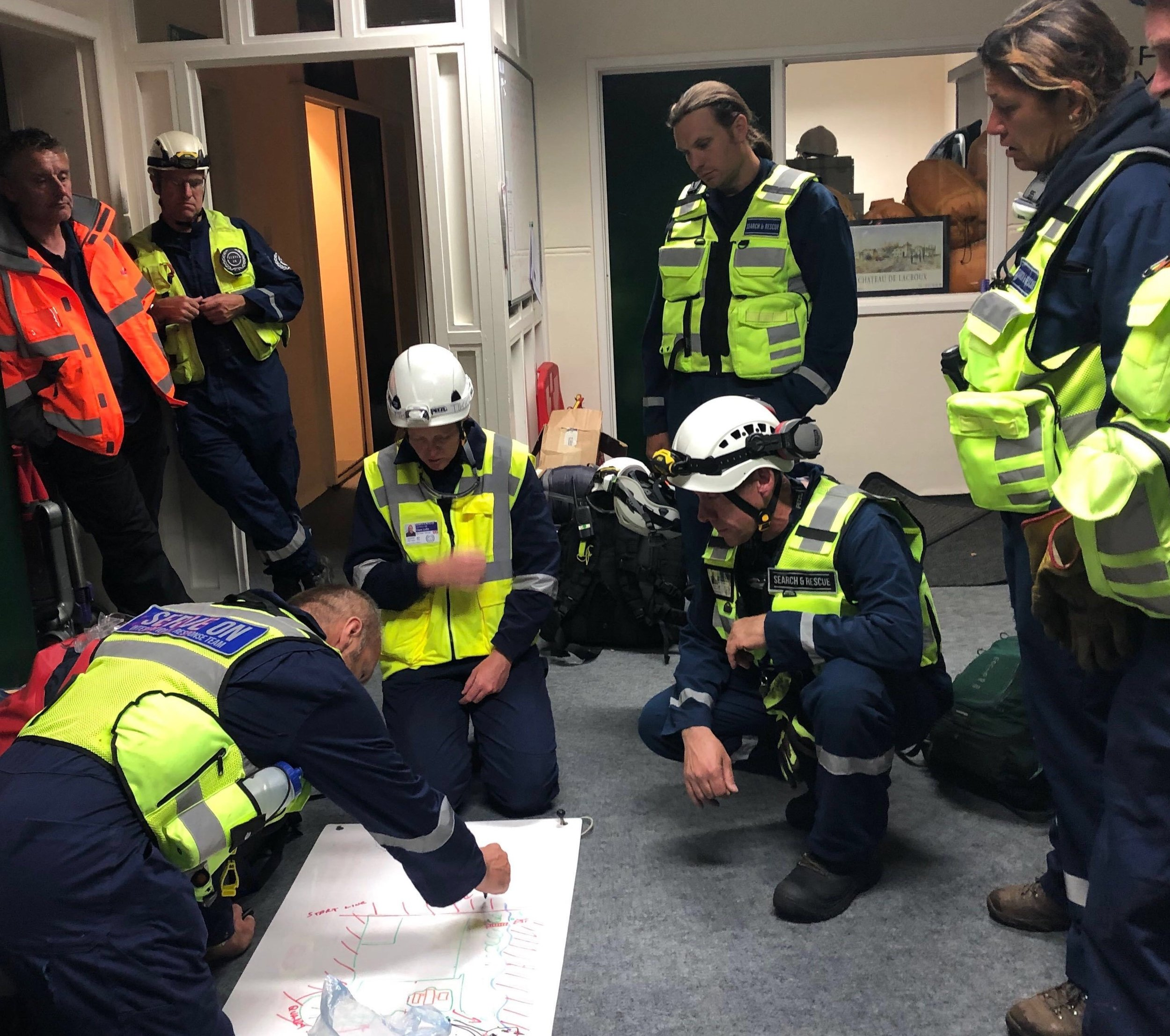 Serve On International Response Team recruits planning their search strategy as they are tasked in the middle of the night with finding a 'missing person'
