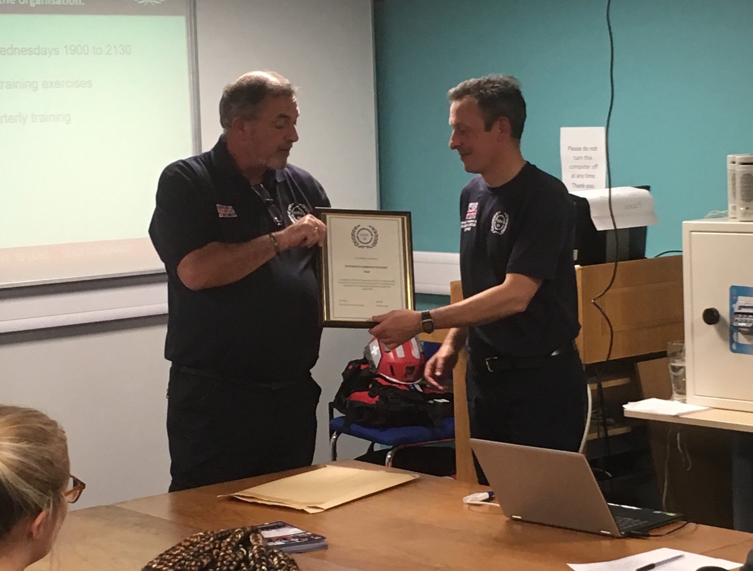 Serve On chief executive Pete Old hands team leader Paul a certificate marking the inauguration of the Portsmouth Community Resilience Team.