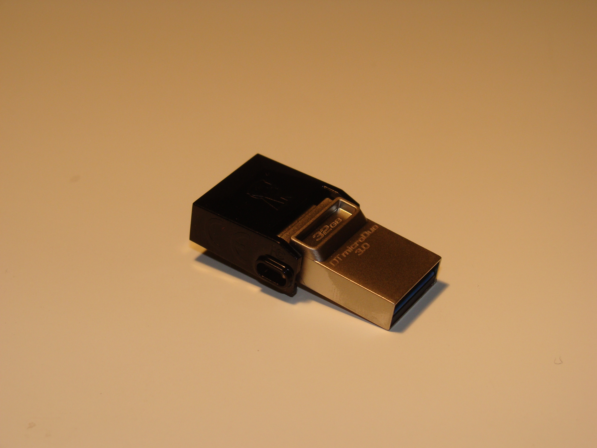 On one end is a standard full sized USB connector