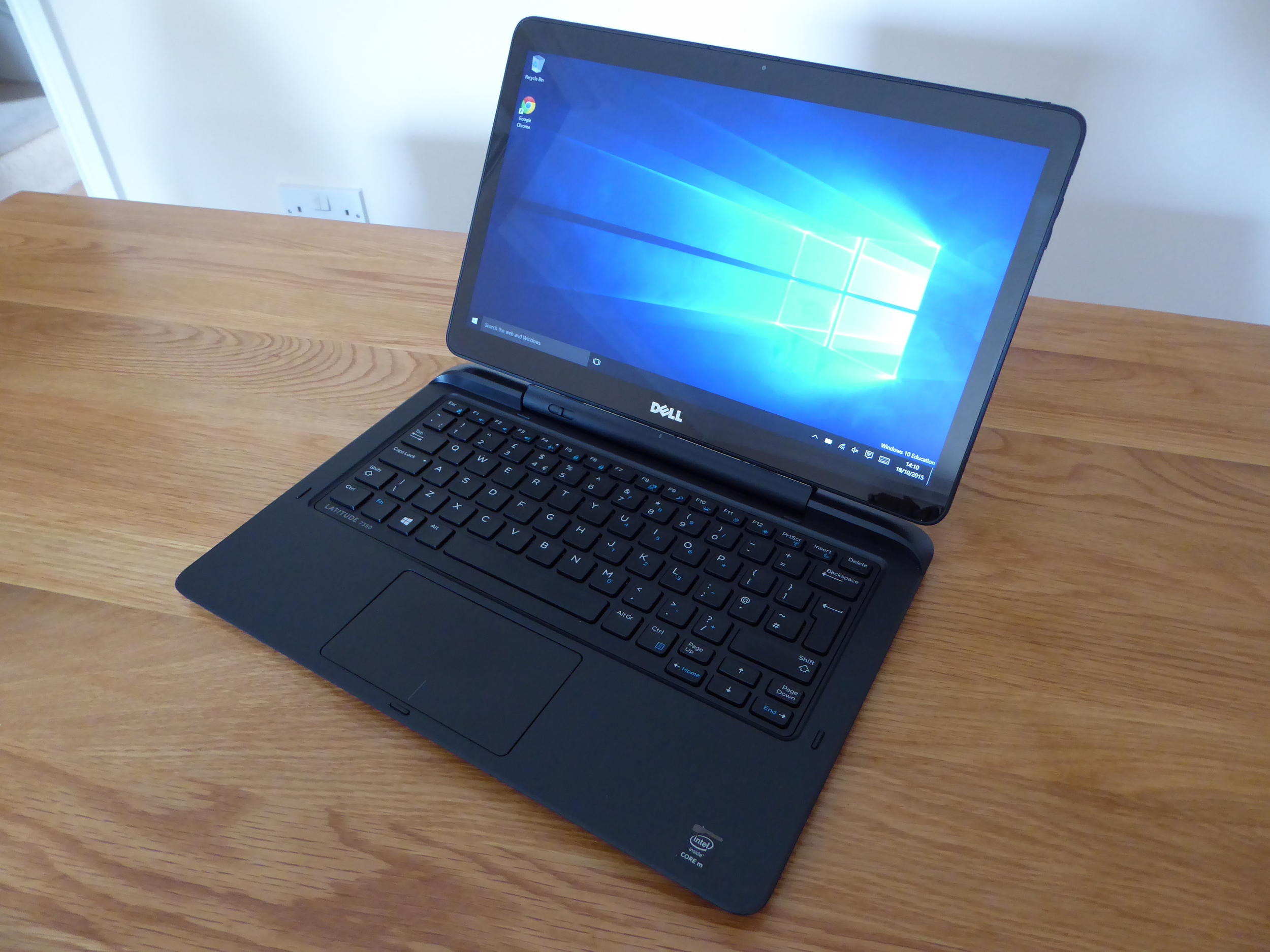 Dell's 2-in-1 costs as much as a Surface Pro or iPad Pro but comes with less shiny