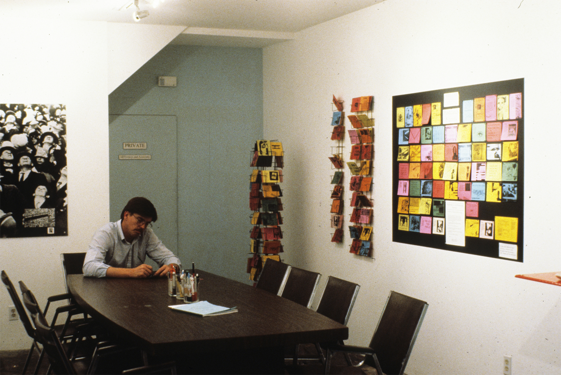 ART PROTECTION SERVICES: Karen Atkinson and Associates, ARTtorneys At Work. Viewer filling out the postcards created for all those on the National Endowment for the Arts Reauthorization Committee.