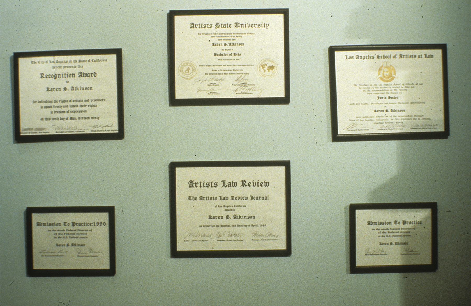 """ART PROTECTION SERVICES: Karen Atkinson and Associates, ARTtorneys At Work. The artist created these awards in order to """"practice law"""". If you look closely, you will see such signatures as Michael Asher, Doug Huebler, Connie Hatch, Emily Cheng, Erika Rotherberg and other artists."""