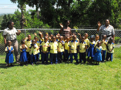 The children and staff with the new school fence!
