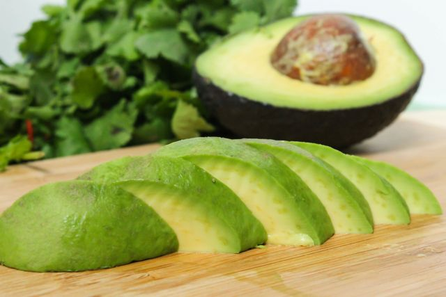 Avocados - Oleic acid, a compound in avocados' healthy monounsaturated fats (MUFAs), may trigger your body to actually quiet hunger. Stick to a quarter or a half of an avocado and watch that belly fat melt away. The creamy fruit is also packed with fiber and protein.
