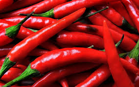 Hot Peppers - Hot peppers get their spicy kick from a compound called capsaicin. And the same compound is responsible for heating up your insides, causing your body to burn extra calories. It's really easy to incorporate hot peppers into your diet: Eat it raw, cooked, dried, or in powdered form. And when in doubt, throw some cayenne or hot sauce onto your meal!