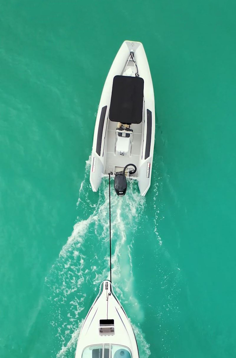 Fi-Glass Invincible RIB towing another boat