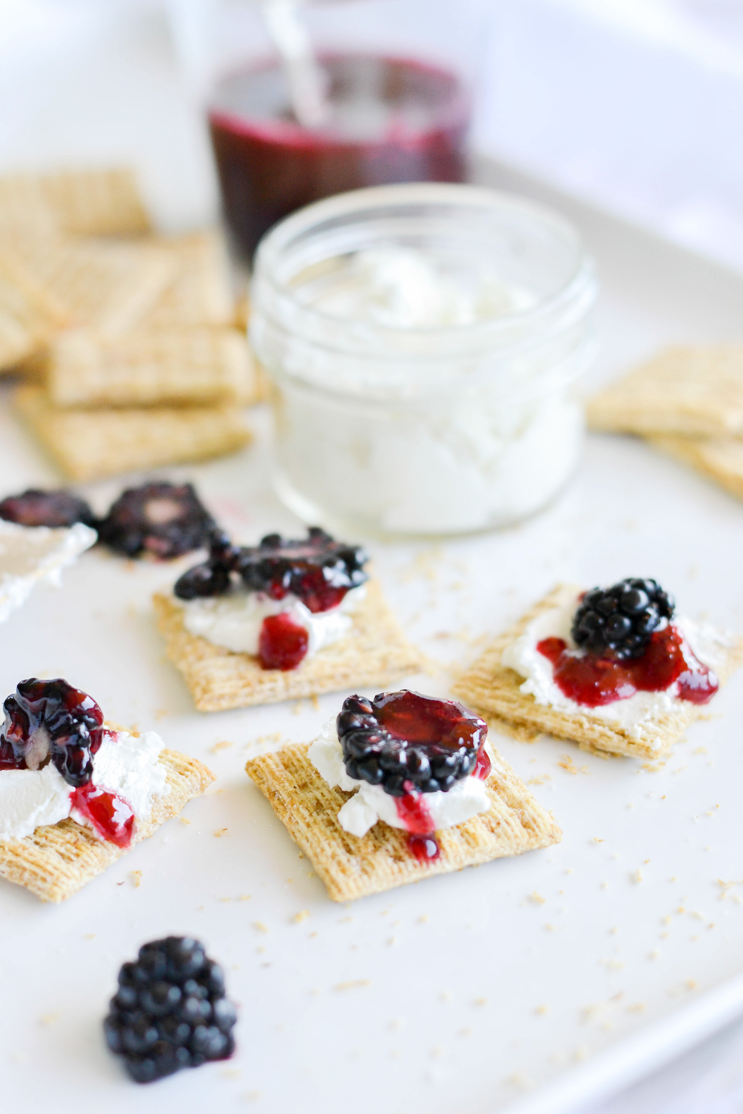 Triscuits, blackberry preserves, and goat cheese - great party food! boxwoodavenue.com