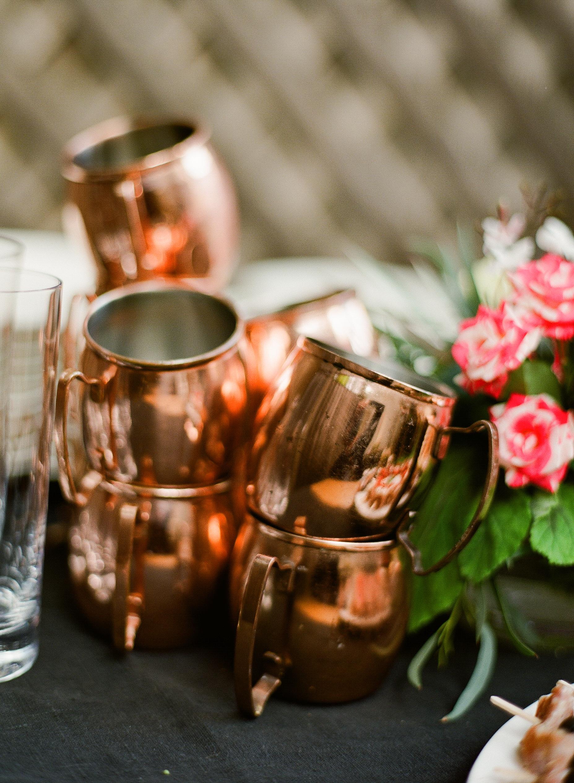stacks of copper mule mugs