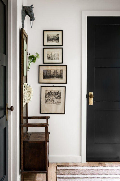 Vintage art & equestrian style entryway | Country Living • Helen Norman