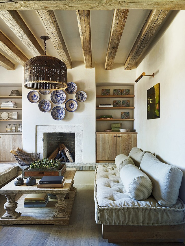 Wood beams placed in the living room bring warmth by David Michael Miller. | boxwoodavenue.com