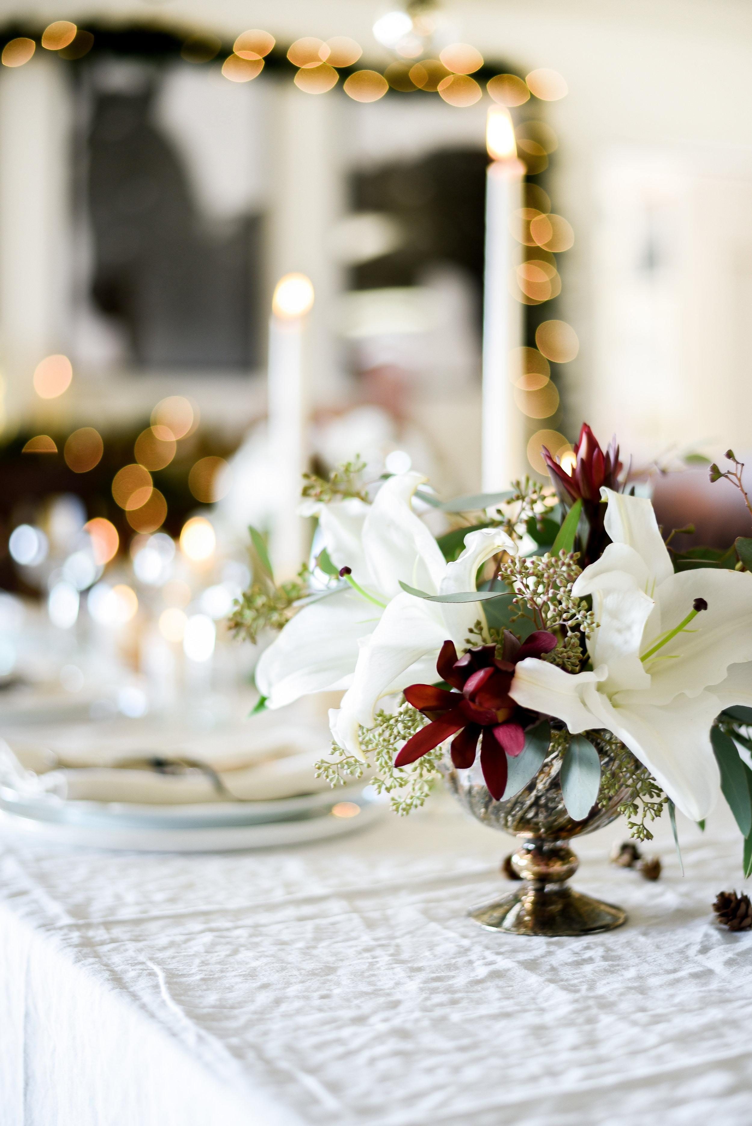 Lily & eucalyptus holiday floral arrangement. boxwoodavenue.com