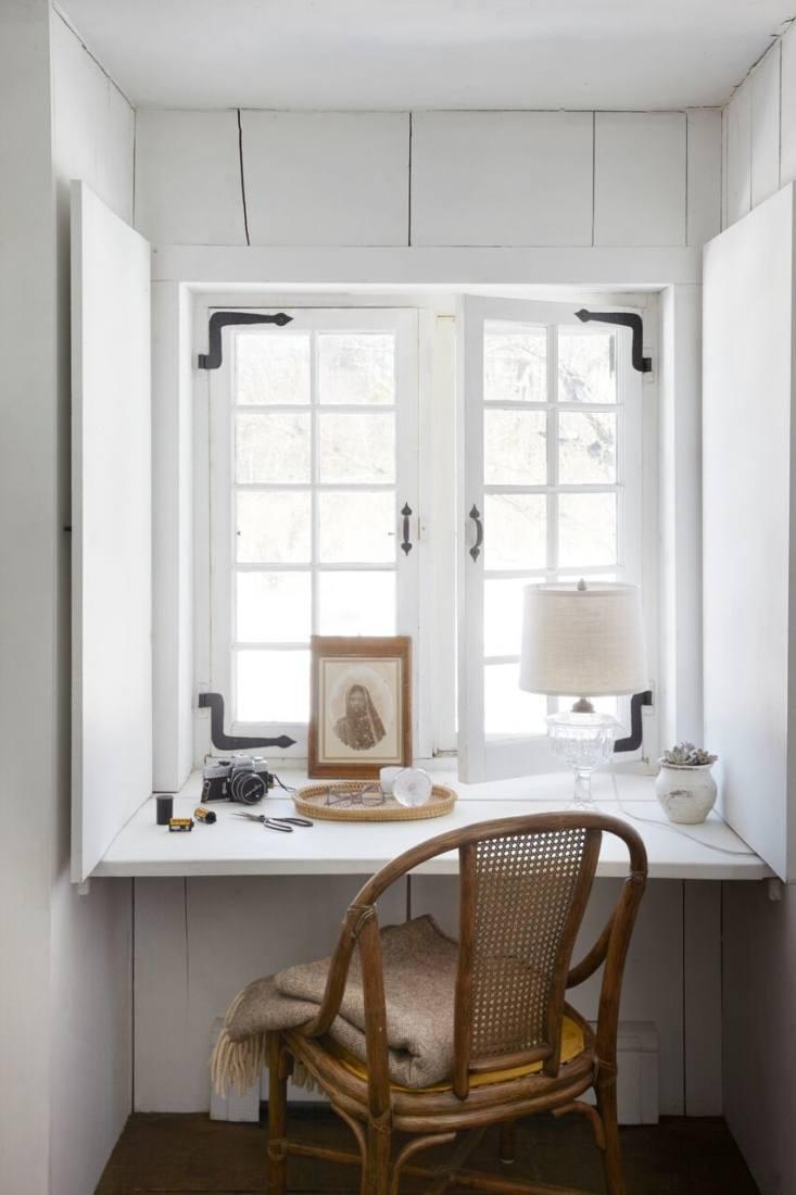 Farmhouse nook with wicker chair & vintage decor [Marili Forastieri by Zio & Sons via Remodelista]